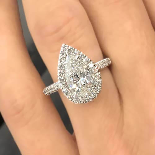 Pear cut moissanite engagement ring