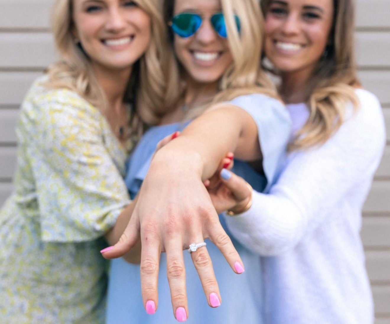 Girl showing off her radiant shape engagement ring
