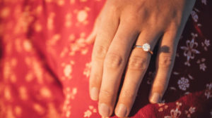 Woman wearing prong based engagement ring