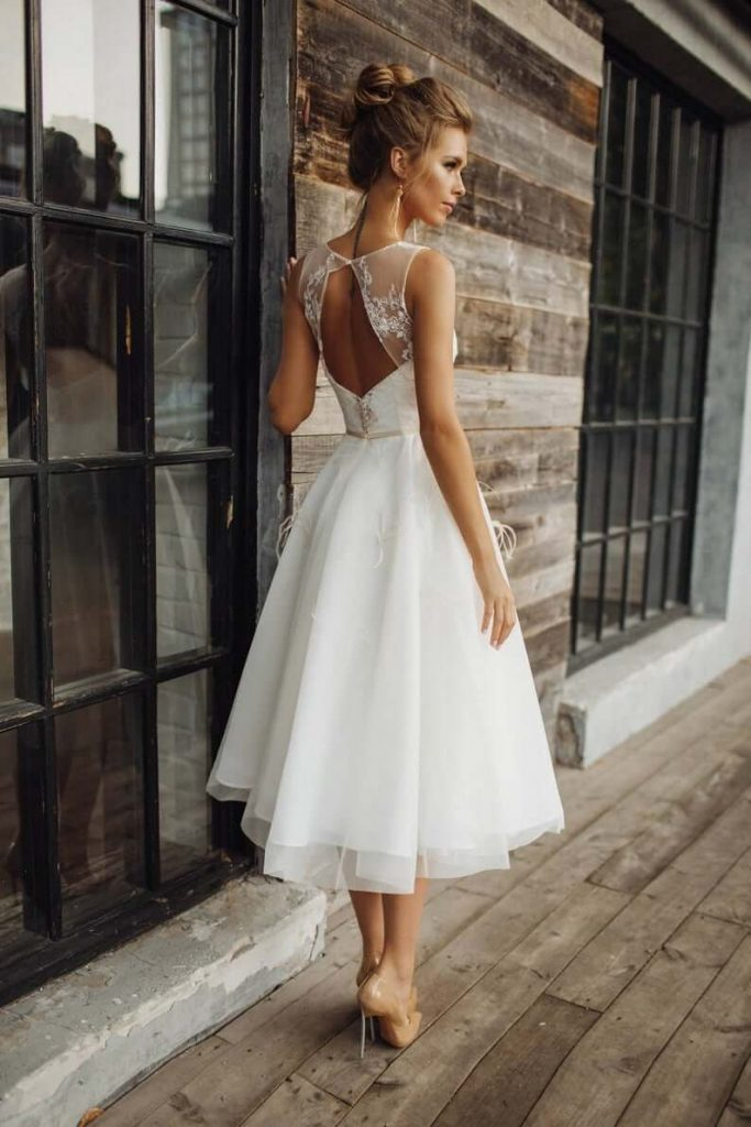 Bride wearing short wedding gown