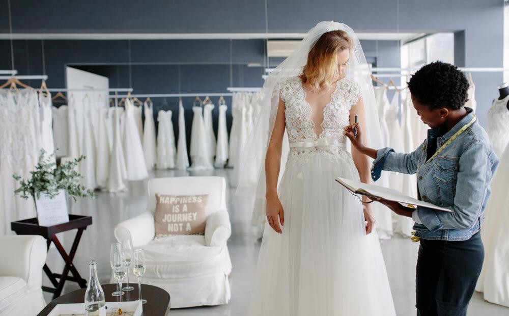 Bride at her wedding dress alteration