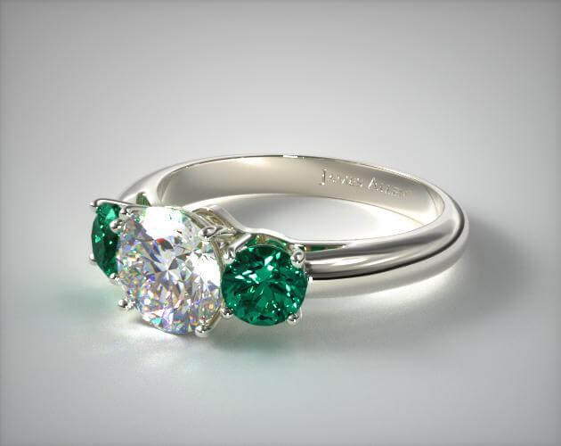 Three-stone emerald and diamond ring