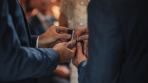 Man giving his wife a Tungsten wedding ring