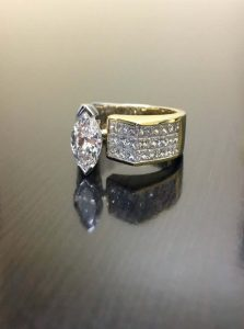 Unique marquise invisible set engagement ring