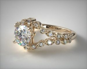 Unique split shank engagement ring in yellow gold