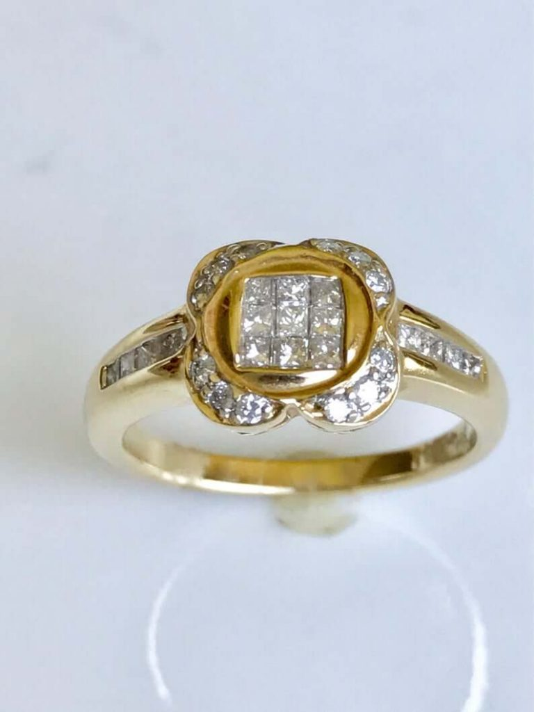 Vintage invisible setting engagement ring