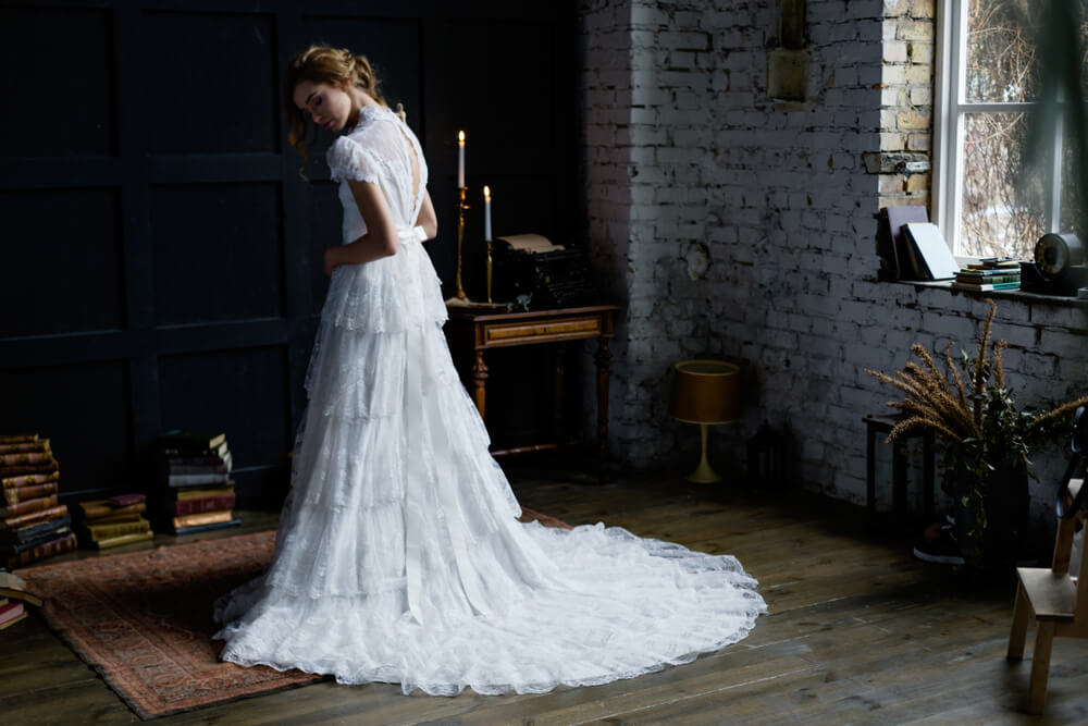 Girl wearing vintage wedding dress