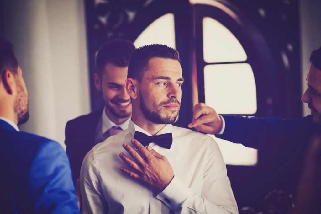 Groom wearing white shirt for wedding day