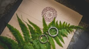 Platinum wedding rings on a leaf