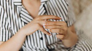 Girl spinning her engagement ring on her finger