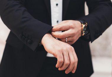Man wearing white gold wedding ring