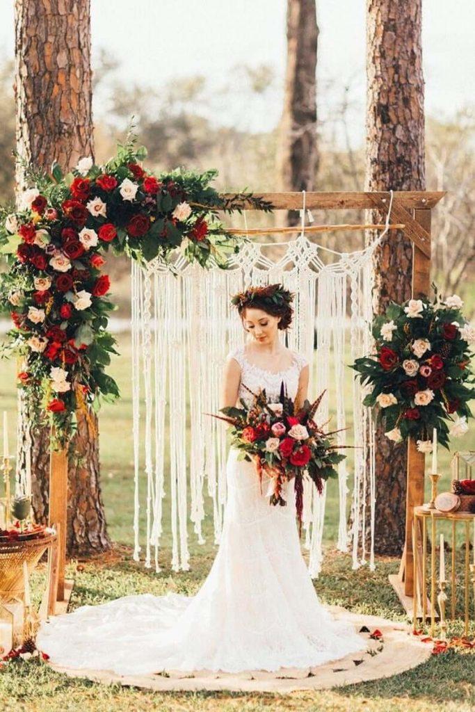Bride under her wedding arch