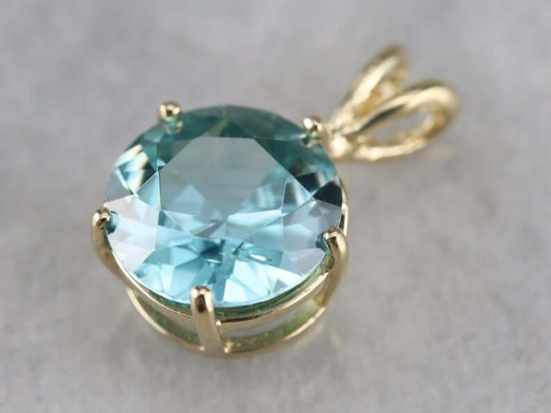 Blue zircon pendant isolated closeup