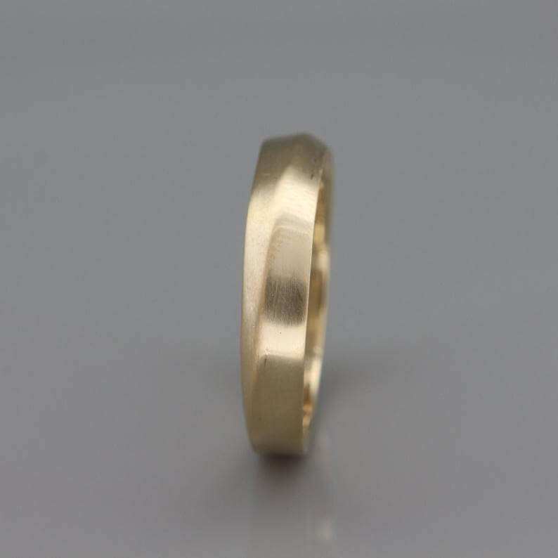 asymmetrical knife edge ring