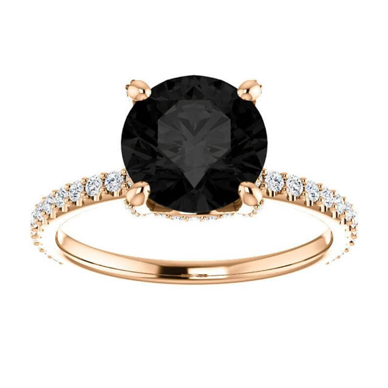 Black diamond engagement ring with yellow gold