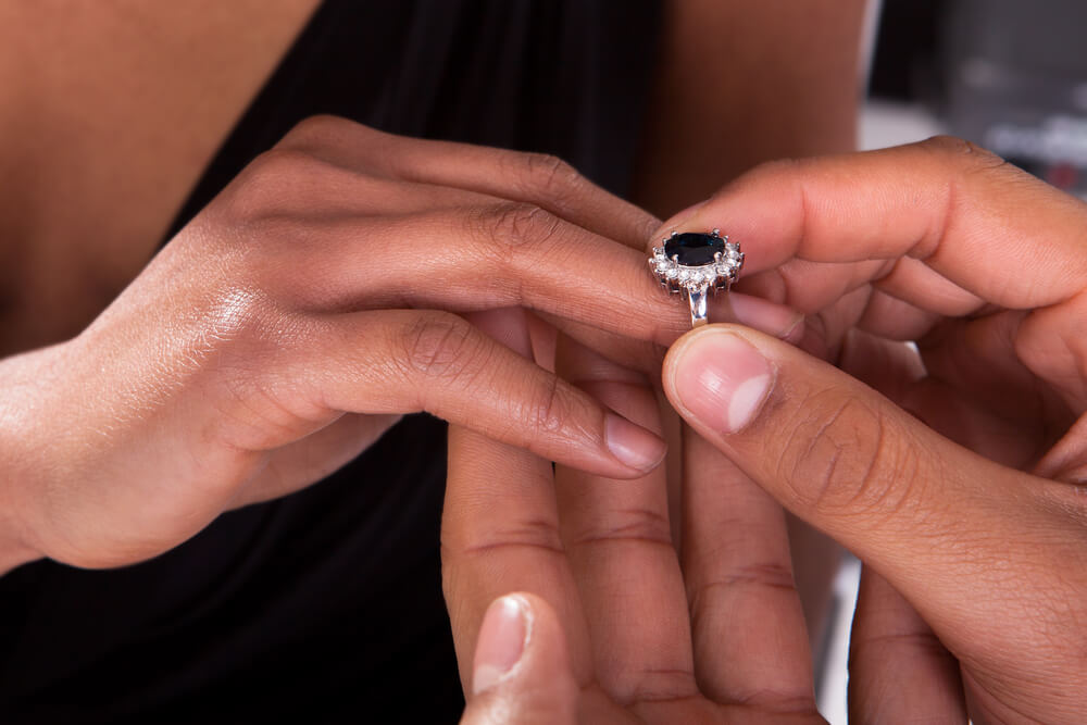 Bride trying black diamond engagement ring on