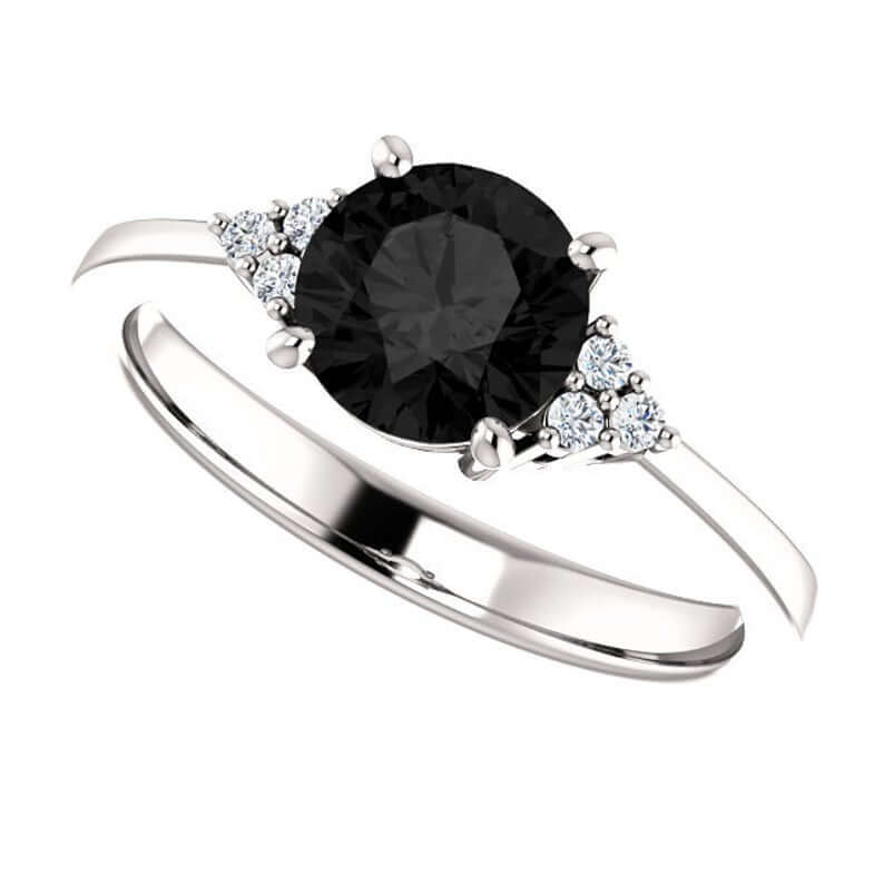 Black diamond ring with round side stones