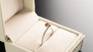Brown diamond engagement ring in a box