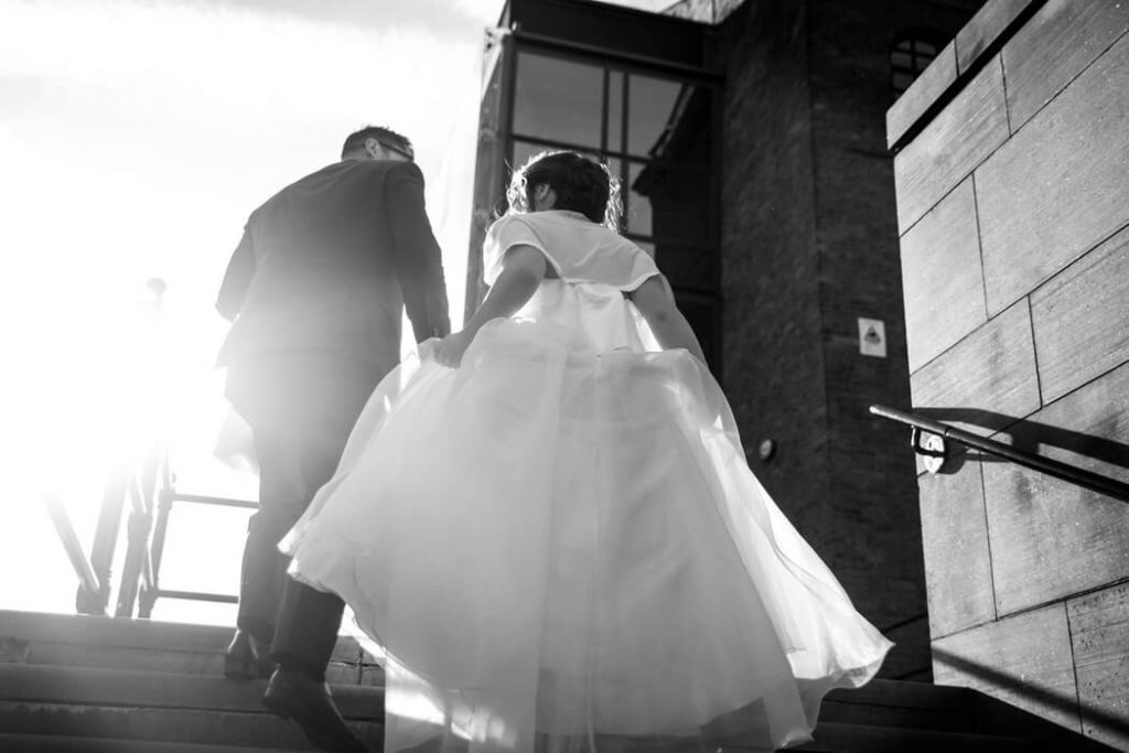 Bride and groom walking to their civil ceremony