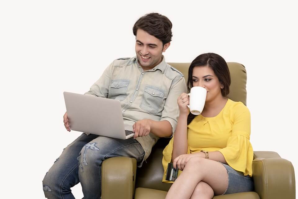 Couple looking looking at laptop