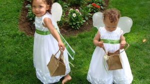 Cute flower girls holding baskets