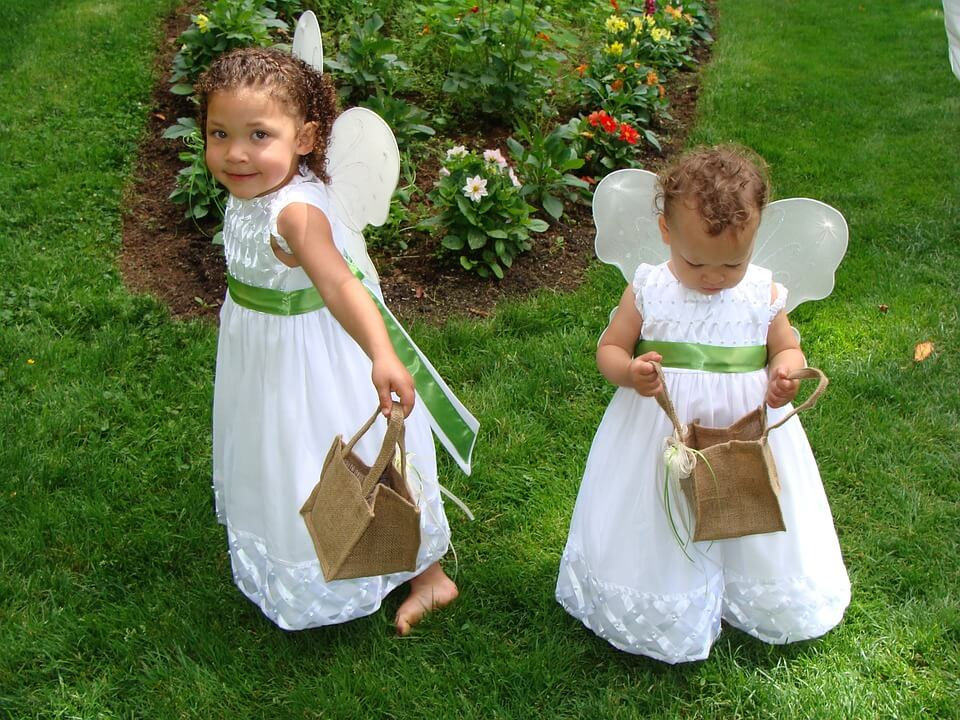 Cute flower girls holding baskets