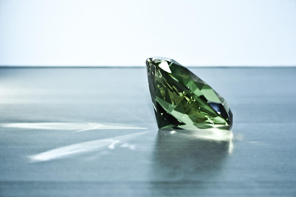 Green diamond round shape in blue background