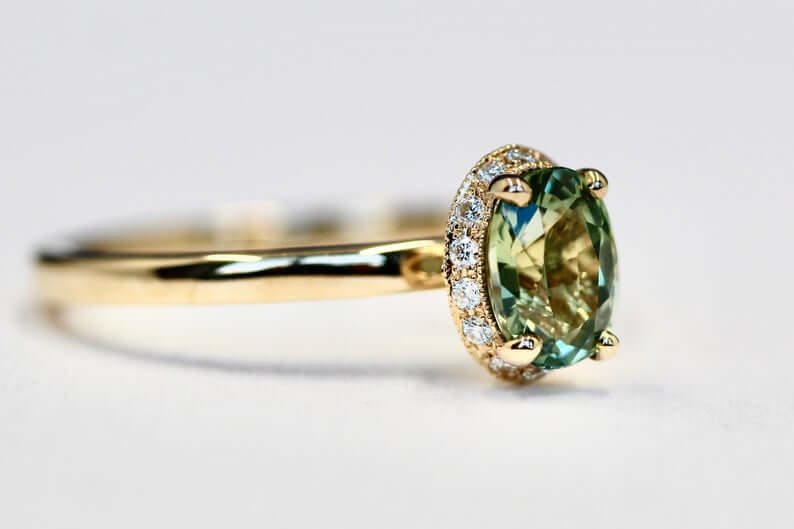 Green sapphire halo engagement ring