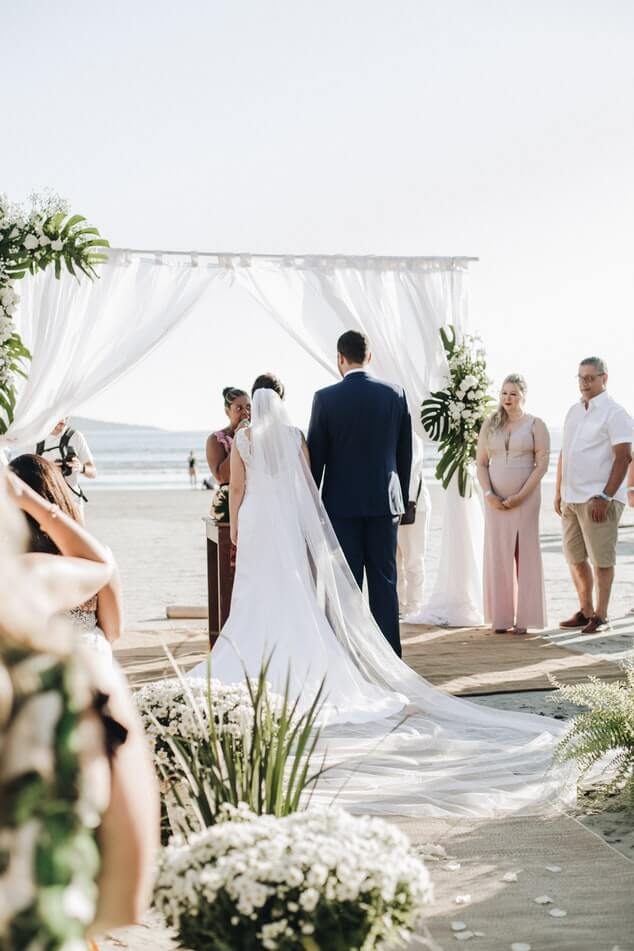 Bride and groom in a beach ceremony