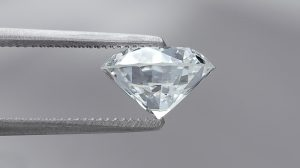 large diamond 2 carat held by tweezers