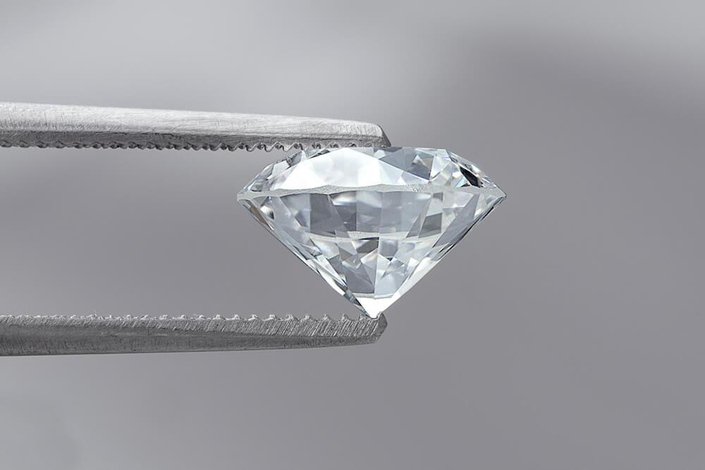 large diamond 2 carat held by tweezers