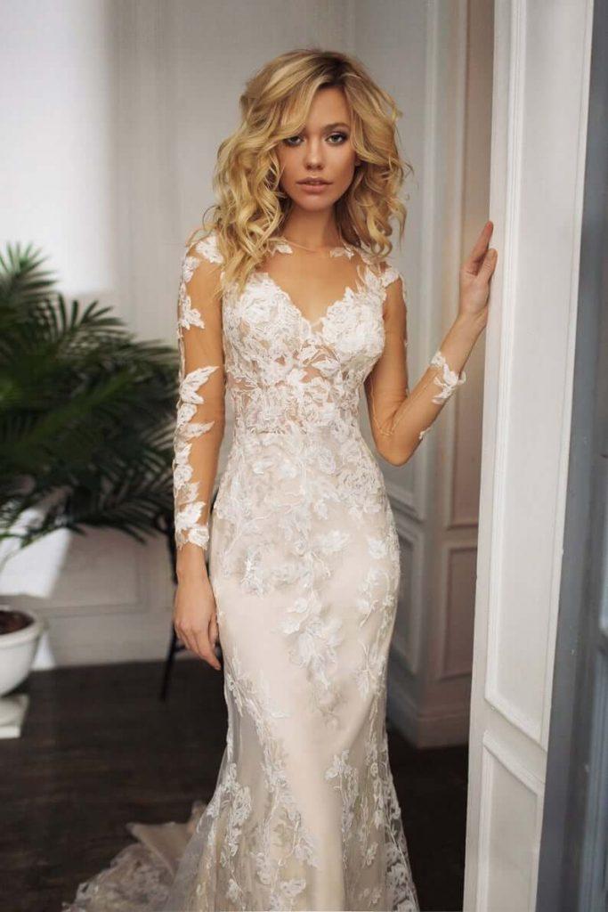 Bride wearing long sleeves illusion wedding dress