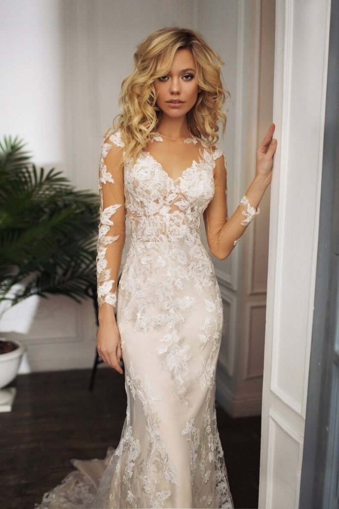 Bride wearing long sleeves illusion wedding dress