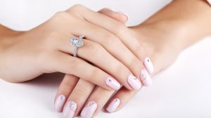 Marquise shape engagement ring on bride's finger