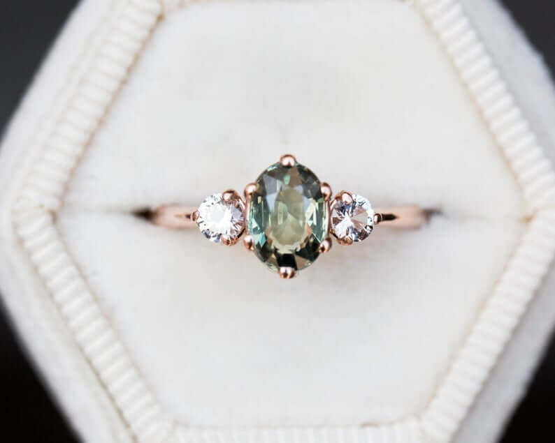 Green sapphire oval setting engagement ring