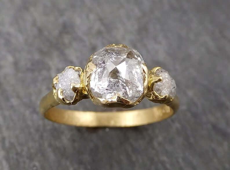 Raw diamond three stone engagement ring
