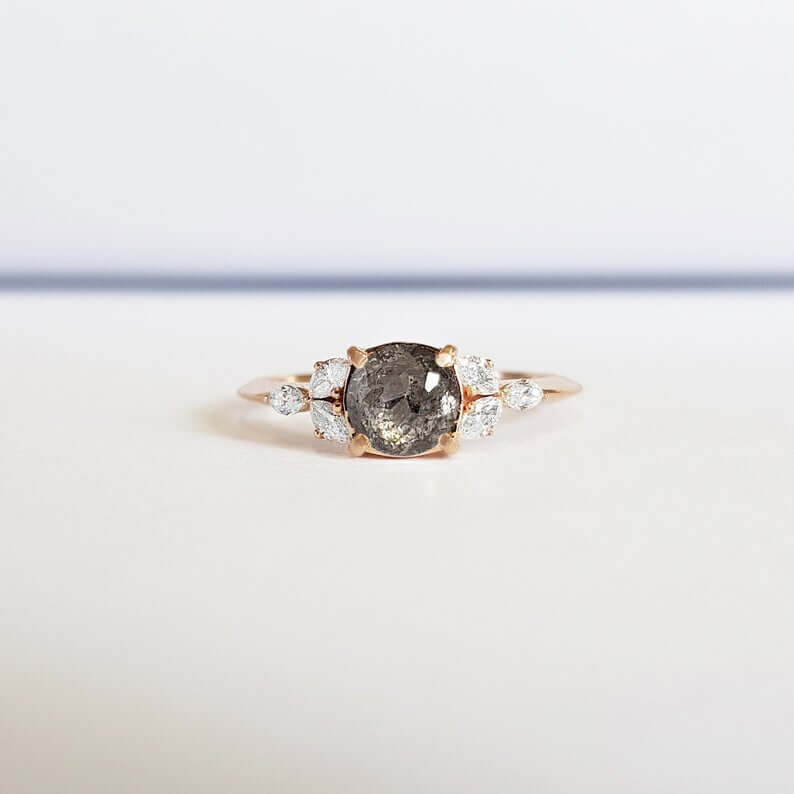 Rose cut salt and pepper diamond engagement ring with side stones