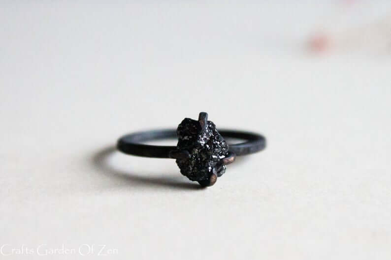 Rough black diamond engagement ring