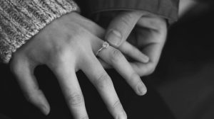 Girl wearing salt pepper diamond engagement ring