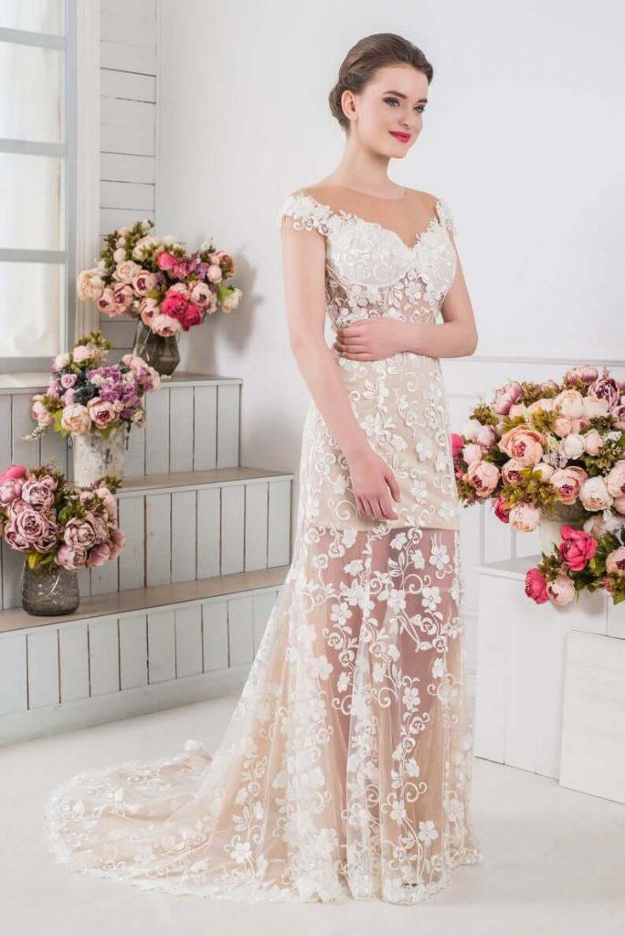 Bride wearing see-through wedding dress