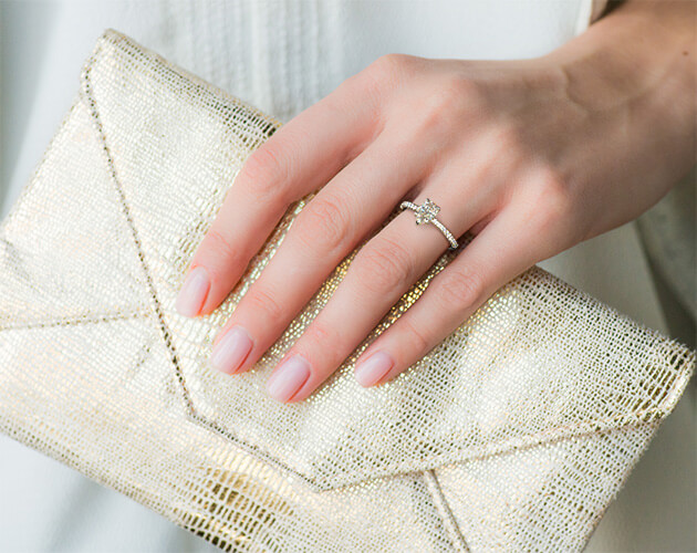 Engagement ring on short fingers