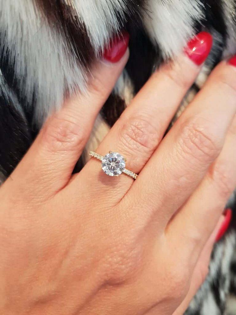 SI1 diamond ring on girl's finger