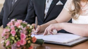 signing wedding couple