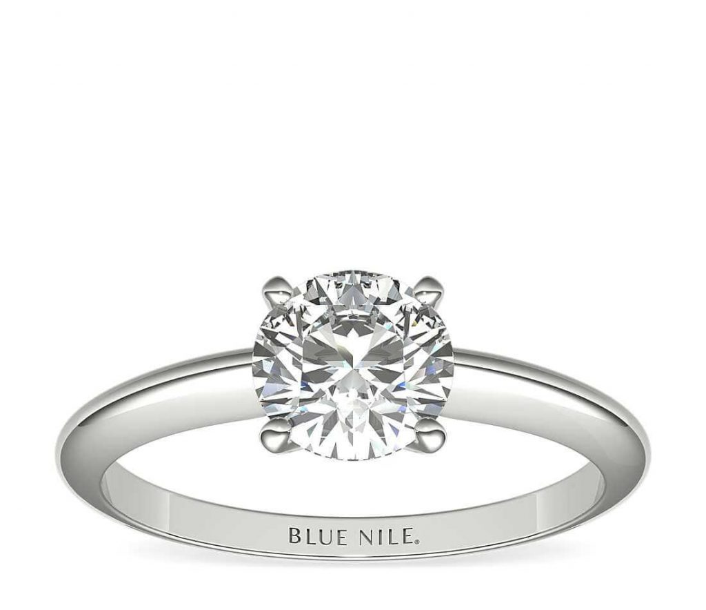 Solitaire setting colorless diamond engagement ring