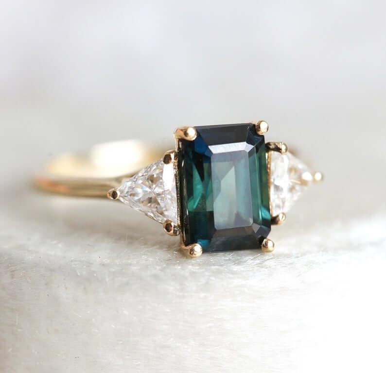 Three stone setting sapphire green engagement ring