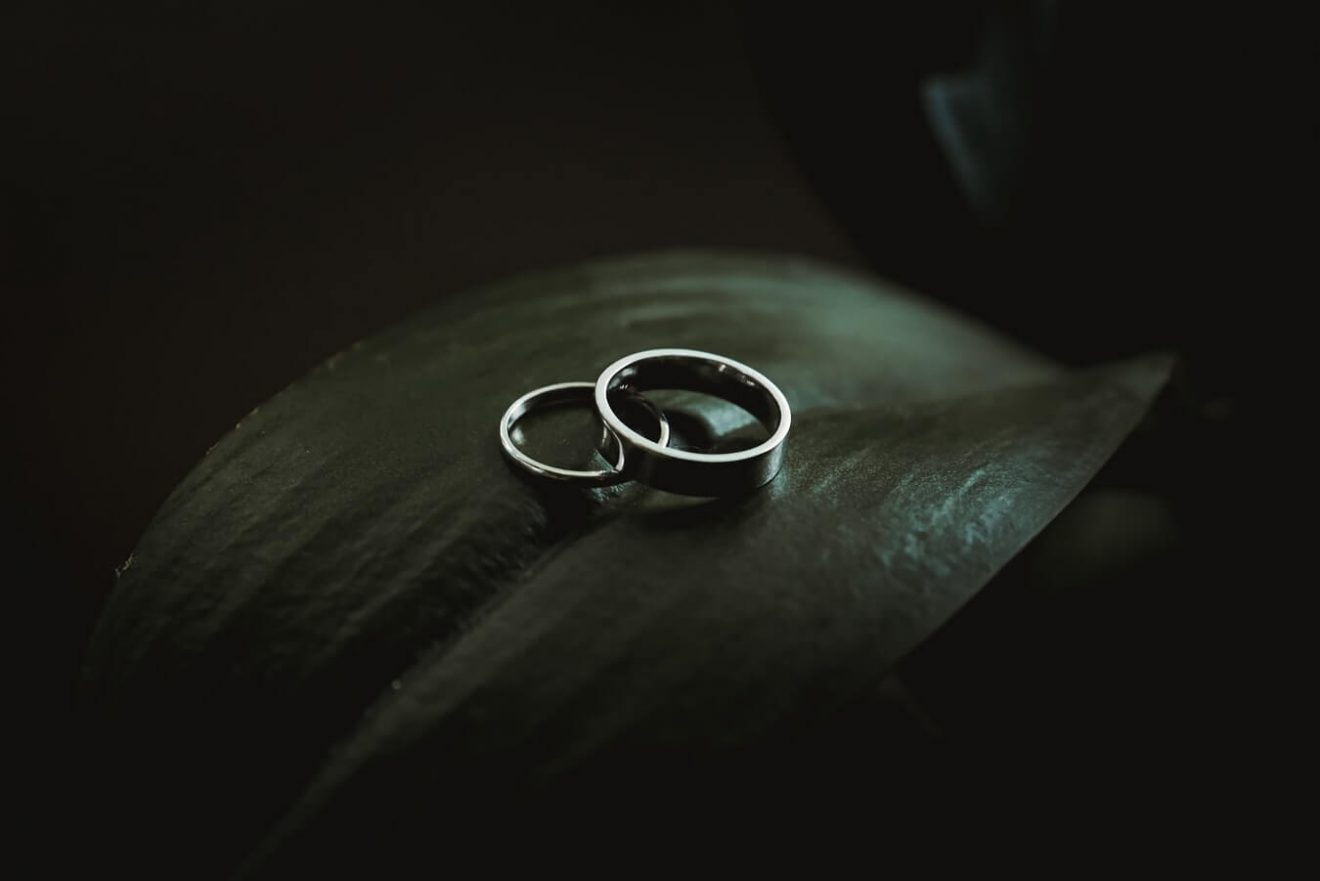 Titanium wedding ring on a leaf