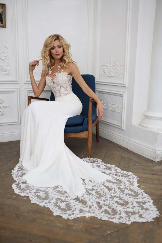 Bride wearing unique-neckline illusion wedding dress