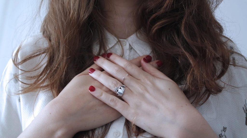 Girl wearing all-in-one ring