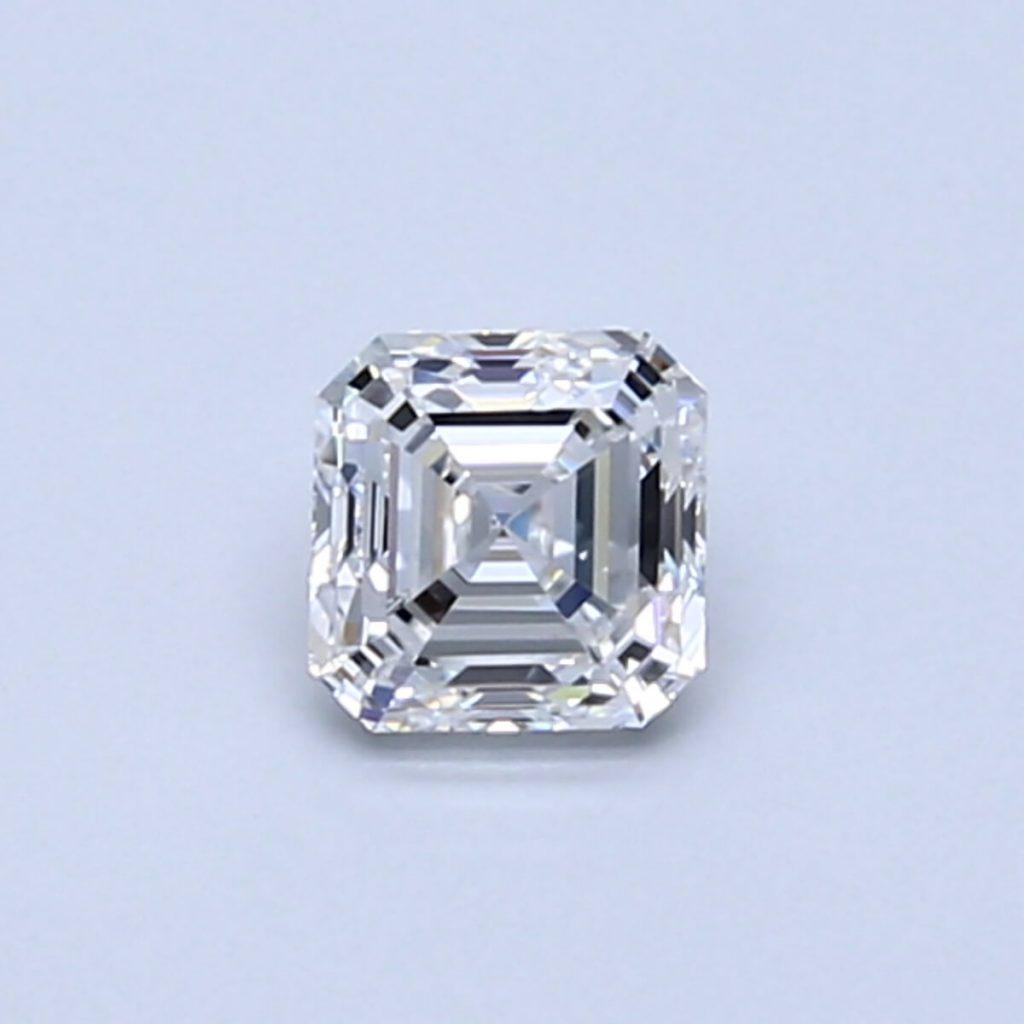 Asscher shape diamond close up on blue background
