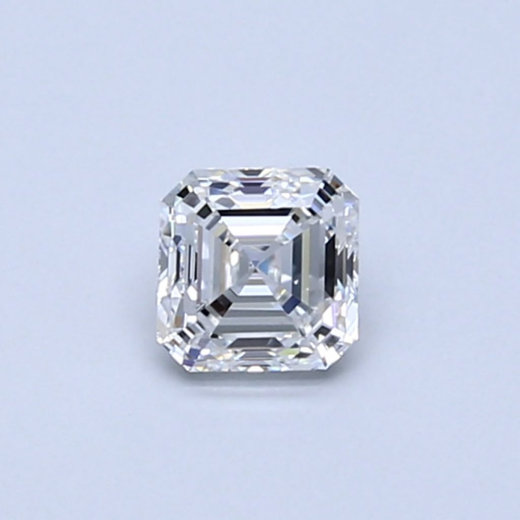 Asscher shape diamond close up on blue background